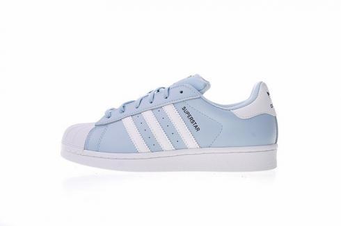 blue and white adidas originals