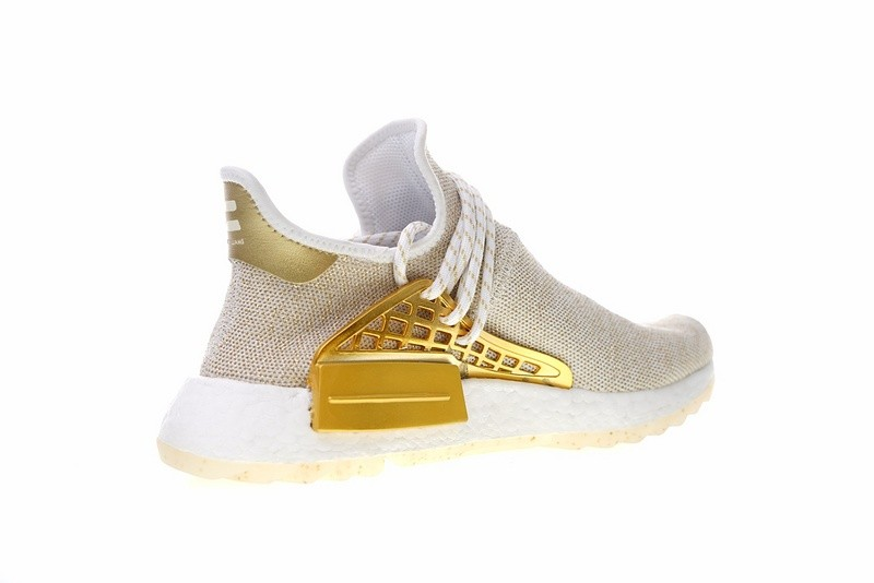 new concept e6b8c 9245e Pharrell Williams x Adidas NMD Hu China Exclusive Happy Gold F99762